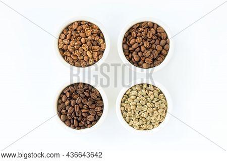 Light Roast, Medium Roast, Dark Roast And Green Coffee Beans In White Ceramic Ramekins Isolated On W