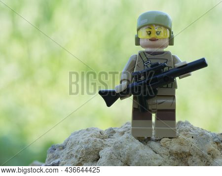 Chernihiv, Ukraine, July 13, 2021. A Girl Soldier Armed With A Rifle. A Small Plastic Toy. Illustrat
