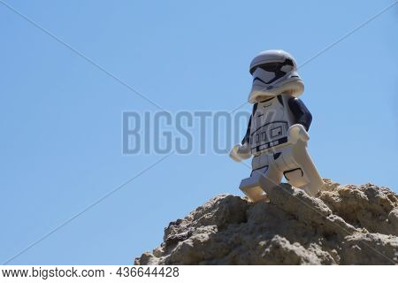 Chernihiv, Ukraine, July 13, 2021. A Plastic Imperial Stormtrooper From Star Wars Against A Clear Sk