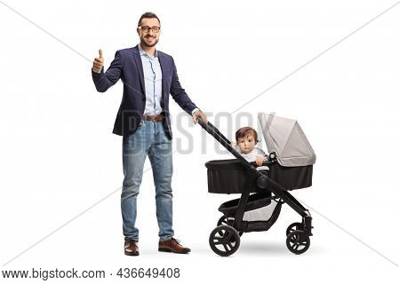Full length shot of a father standing with a baby in a carriage and gesturing a thumb up sign isolated on white background