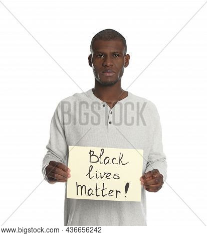African American Man Holding Sign With Phrase Black Lives Matter On White Background. Racism Concept