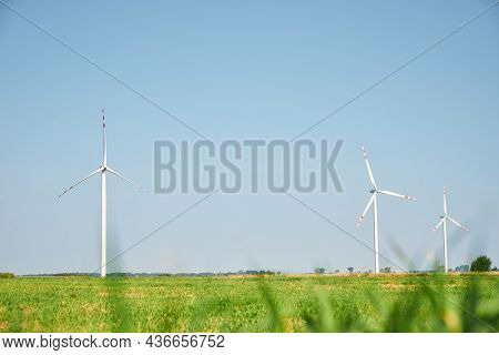 Renewable Green Energy Concept. Windmills Turbines In The Field.