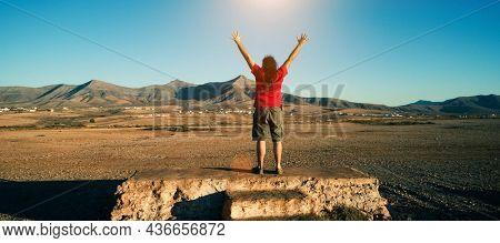 Man enjoys the sun at sunset