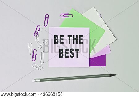 Be The Best - Text On Sticky Note Paper On Gray Background. Closeup Of A Personal Agenda. Top View