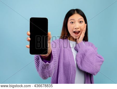 Wow, Amazing App. Surprised Asian Lady Holding Smartphone With Black Blank Screen, Showing Device, C