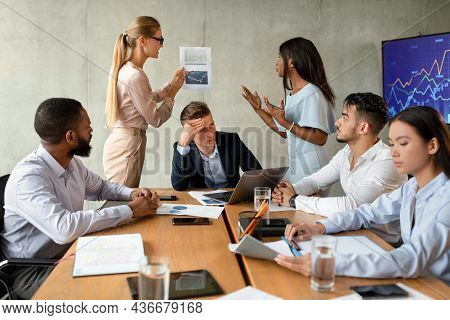Business Conflicts. Two Female Employees Arguing During Corporate Meeting In Office