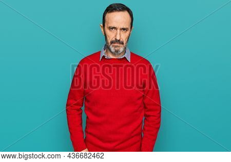 Middle age hispanic man wearing casual clothes depressed and worry for distress, crying angry and afraid. sad expression.