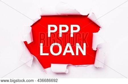 Torn White Paper Lies On A Red Background. On Red, The Text Is White Ppp Loan