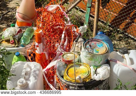 Waste Post Repair And Painting Garbage Plastic And Residues Of Chemicals Lie On The Grass, Environme