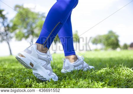 Young Athlete Woman Close Up Shot Of Runner's Shoes