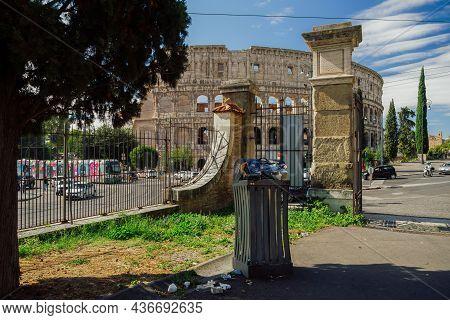 Rome, Italy - October 9 2021: Garbage Bin Full Of Litter Before The Colosseum. Trash Outside Dumpste