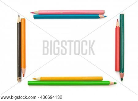 Colorful frame of wood pencils shavings on white background. Isolated object.