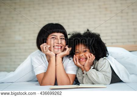 Happy Cute Little Preschool Child Daughter Reading Book Learning Education Whit Mom. Concept Of Happ