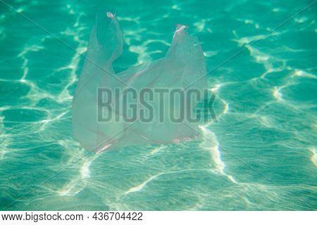Ocean pollution. Plastic bag underwater.