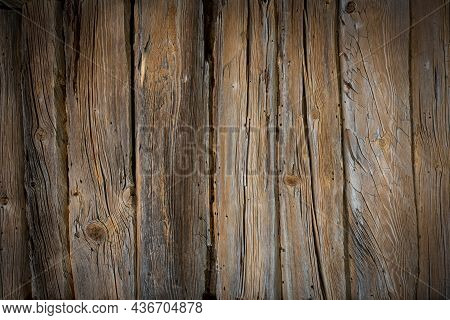 Wooden Logs Of An Old House. Close-up. Weathered Natural Gray Wood Texture. Background. Horizontal P