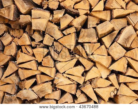 Closeup of well stacked firewood.Can be used as natural background texture poster