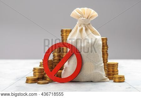 Prohibition Sign. Money Bag And Stacks Of Coins On A Gray Background. No Symbol And Money