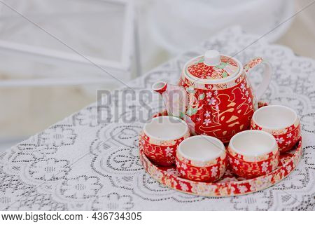 Tea Set Used In A Chinese Wedding Tea Ceremony. Chinese Wedding Tea Ceremony Serving To Elders. The