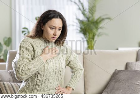 Stressed Woman Is Suffering From A Chest Pain. Pressure In The Chest.