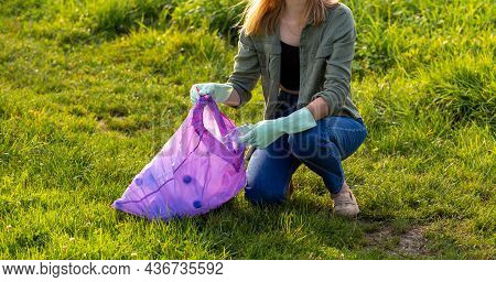 Banner Volunteer Hands Picks Up A Plastic Trash. Woman Collect Plastic Bottles On The Grass In The P