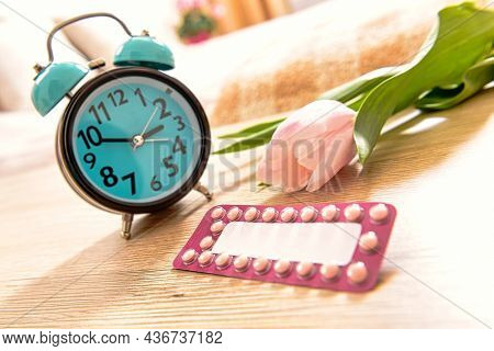 Birth control pills and  clock, remember to take the contraceptive pill