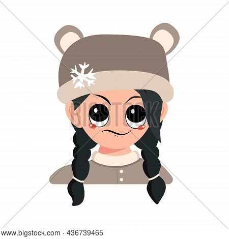 Girl With Emotions Of , Displeased Eyes And Black Hair In Bear Hat With Snowflake. Cute Child With A