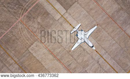 Parked Expensive Private Airplane On Concrete Ground Of Airport, Aerial. Small Business Jet Parked O