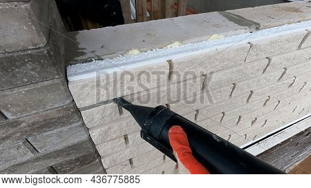 The Process Of Hammering In The Seams In The Facade Of The Tiles. Grouting The Seam On The Facade Of