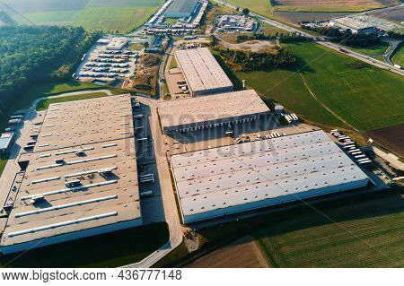 Parking Lot For Semi Trucks Near Factory, Top View. Aerial View Of Truck Trailers Parked For Waiting