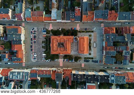 Aerial View Of Old European City. Central Square Of Small Town Cityscape With Building Roofs, Top Vi