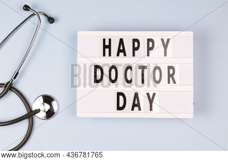 Creative Top View Flat Lay Lightbox With The Text Happy Doctor Day. Doctor's Day Concept, Stethoscop
