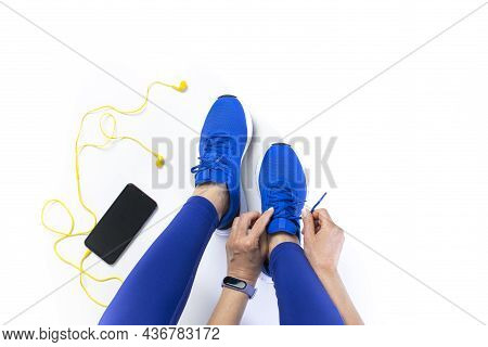 Young Woman Tying Shoelace Before Workout, Getting Ready For Jogging