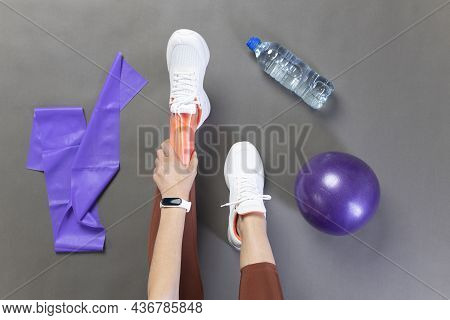 Ankle Pain In Detail. Young Athlete Woman Top View - Sports Injuries Concept