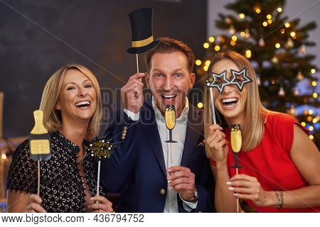 Business friends celebrating christmas party. High quality photo