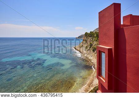 Geometric Red Building Design And Mediterranean Coastline. Calpe, Spain