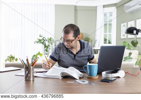 Young Freelance Man Working From Home. E-learning