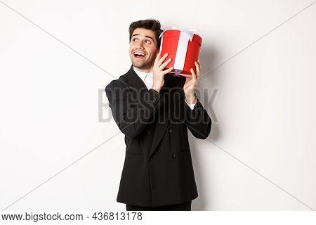 Concept Of Christmas Holidays, Celebration And Lifestyle. Image Of Excited Man Enjoying New Year, Sh