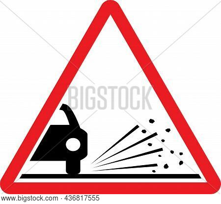 Loose Chippings Road Sign. Red Triangle Background. Traffic Signs And Symbols.