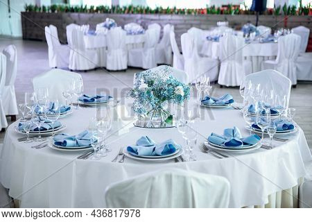 The Banquet Hall With Round Tables. Restaurant Banquet Hall With Served Decorated Wedding Tables. Ro