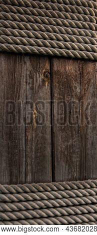 Hemp rope on weathered wood background