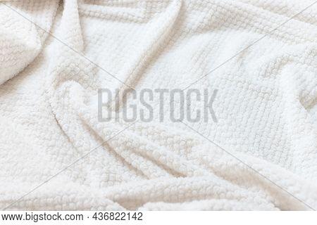 Beige Delicate Soft Background Of Plush Fabric. Wrinkle Fleece Blanket. Fuzzy Soft Texture. Side Vie