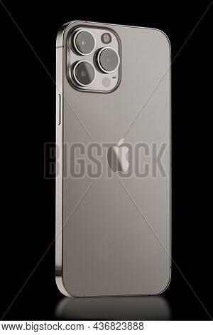 Iphone 13 Pro Max On A Black Background. Three Close-up Phone Cameras, Apple Logo. Russia, Krasnoyar