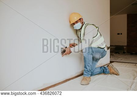 Contractor remodeling a home in the new normal