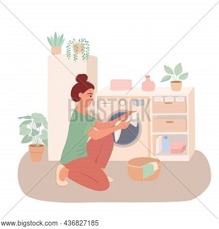 A Young Woman Is Doing Laundry. Housewife Puts Clothes In The Washing Machine. Wardrobe, Laundry Bas