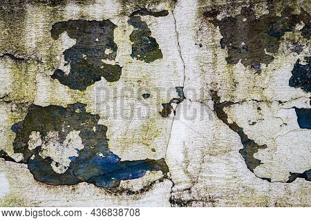 Destroyed Shabby Wall. Texture Of Cracked Peeling Plaster And Paint. Facade Of An Abandoned Building