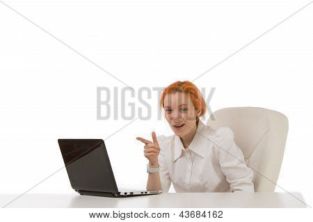 Smiling Businesswoman Pointing At Her Laptop