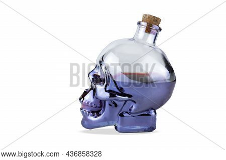 Skull Shaped Glass Bottle With Cork With Purple Liquid Inside, Isolated On White Background