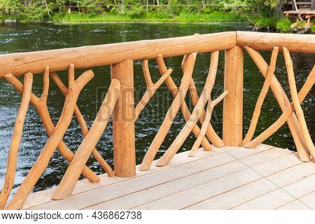 Natural Wooden Railings Of An Empty Footbridge In A Summer Park, Background Photo