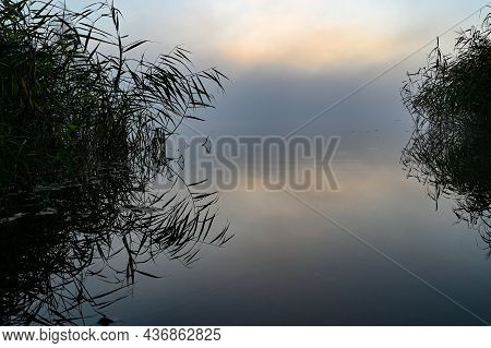 Early Morning Overlooking Misty Lake And Sunrise
