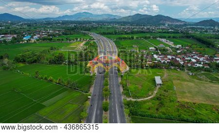 Aerial View Of The City Colorful Monument Tembolak Rainbow On Mataram. The Newest Icon From The City